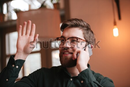 Man in plaid shirt looking at the mirror at home Stock photo © deandrobot