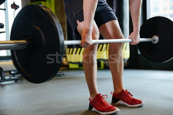 Obraz człowiek wykonywania sztanga siłowni Zdjęcia stock © deandrobot