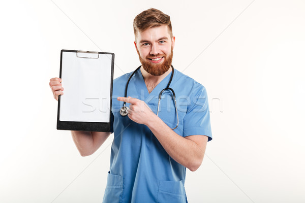 Portrait of happy friendly young medical doctor or a nurse Stock photo © deandrobot