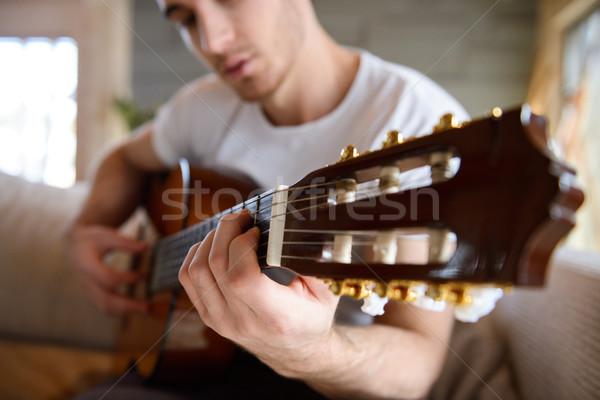выстрел гитаре рук человека сидят Сток-фото © deandrobot