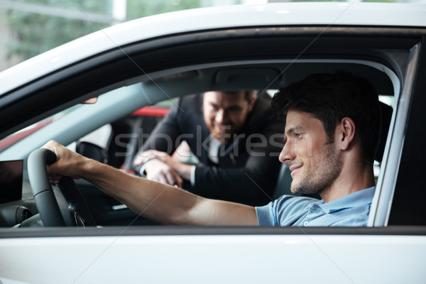 Stock photo: Young man testing his new car