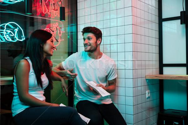 улыбаясь любящий пару сидят кафе Сток-фото © deandrobot