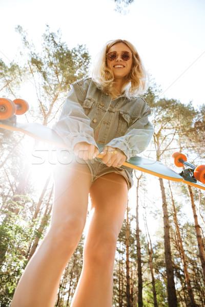 удивительный женщину скейтборде улице фотография Сток-фото © deandrobot