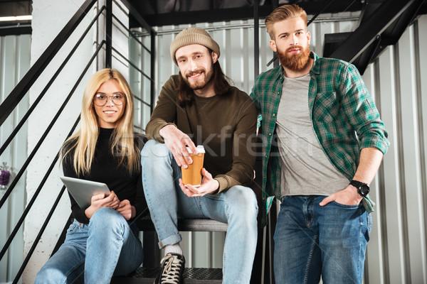 Mosolyog kollégák iroda ül létra kép Stock fotó © deandrobot