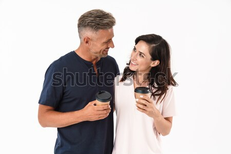 Stock photo: Offended young loving couple standing isolated
