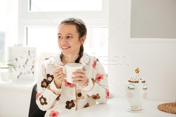 женщину пижама питьевой кофе Сток-фото © deandrobot