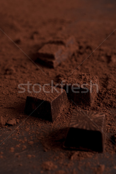 Close up of chocolate candies covered with dark powder Stock photo © deandrobot