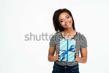 Portrait of a young afro american woman holding present box Stock photo © deandrobot