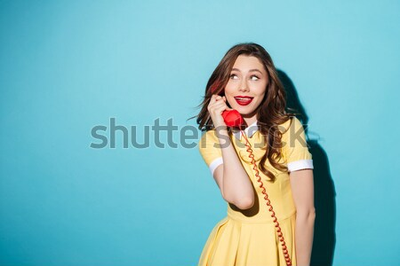 Flirty kobieta sukienka wskazując palec Zdjęcia stock © deandrobot