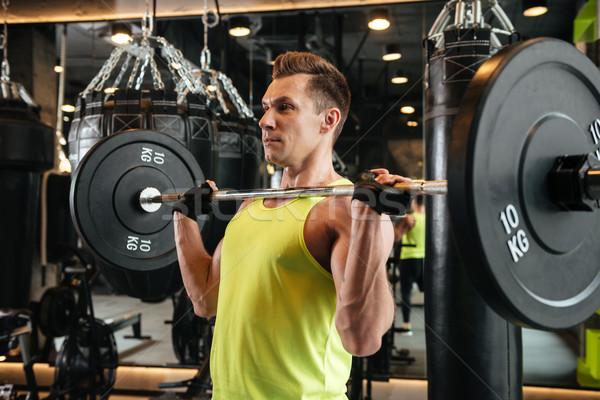 мышечный сильный спортсмен штанга Сток-фото © deandrobot