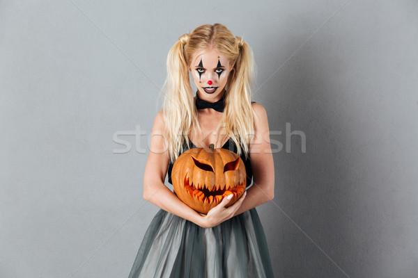 Pretty blonde woman in halloween clown make-up Stock photo © deandrobot