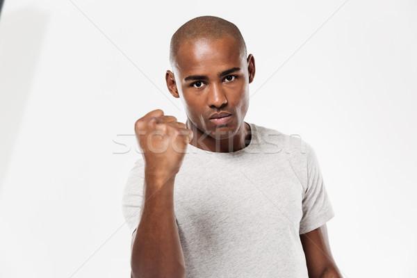 Ciddi genç Afrika adam yumruk Stok fotoğraf © deandrobot