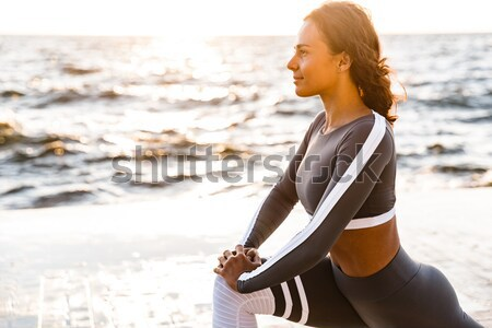 Stock photo: Young charming sport woman resting after workout, looking aside