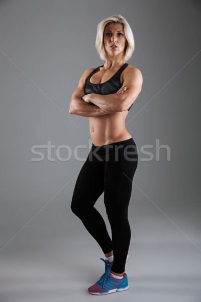 Stock photo: Full length portrait of a serious muscular adult sportswoman