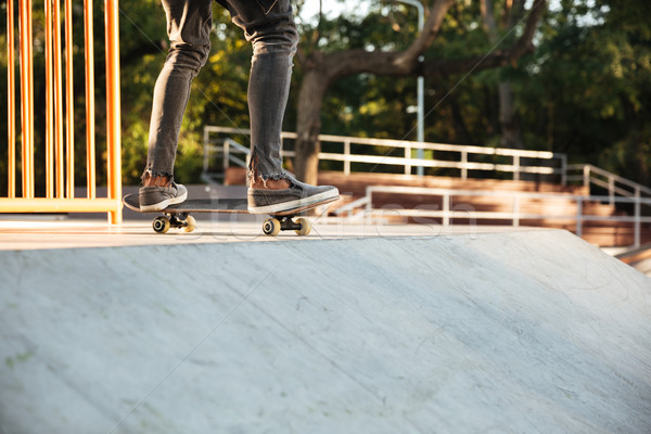 Close up of a young teenage skateboarder in action Stock photo © deandrobot
