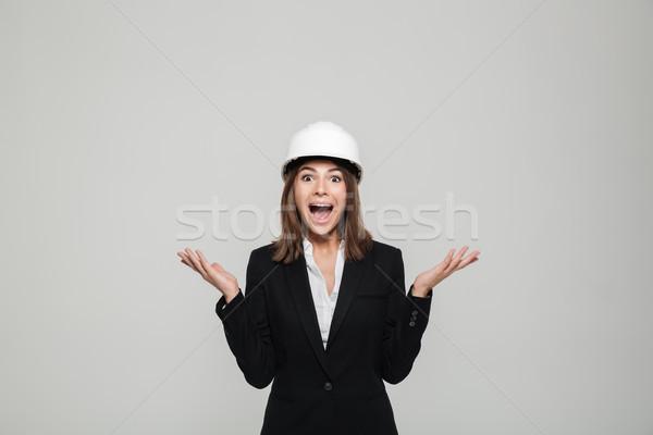 Portré izgatott derűs nő védősisak öltöny Stock fotó © deandrobot
