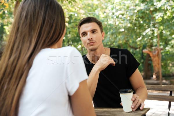 молодые скучно человека сидят питьевой кофе Сток-фото © deandrobot