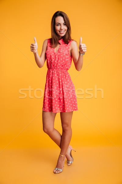 Full-length portrait of young happy woman standing with crossed  Stock photo © deandrobot