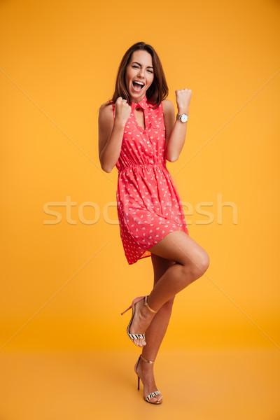 Teljes alakos fotó fiatal érzelmes barna hajú nő Stock fotó © deandrobot