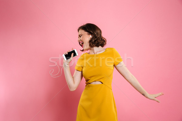 Portrait of a cheerful woman in dress and make up Stock photo © deandrobot