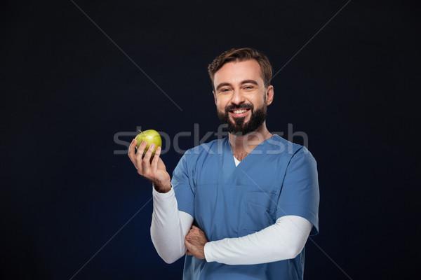 Retrato feliz doctor de sexo masculino uniforme verde Foto stock © deandrobot
