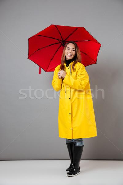 Teljes alakos portré boldog lány esőkabát gumicsizma pózol Stock fotó © deandrobot