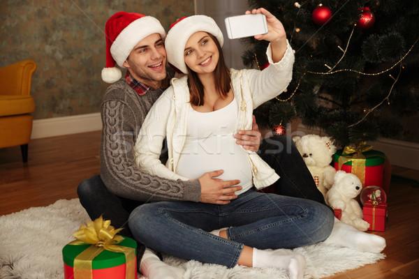 幸せ かなり 妊婦 夫 祝う クリスマス ストックフォト © deandrobot