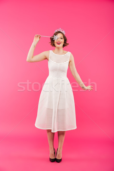 Full length portrait of a happy girl wearing crown Stock photo © deandrobot