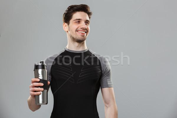 Portré mosolyog fiatal sportoló tart vizes flakon Stock fotó © deandrobot