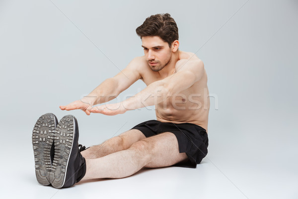 Portrait of a confident young half naked sportsman Stock photo © deandrobot