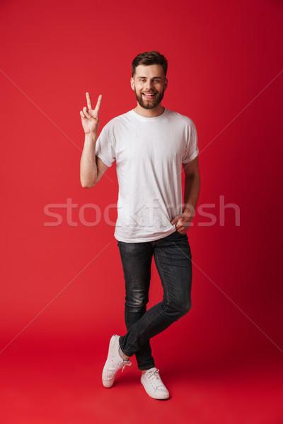 幸せ 若い男 立って 孤立した 平和 ストックフォト © deandrobot