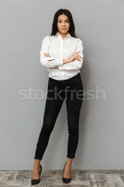 Full length image of caucasian woman with long brown hair wearin Stock photo © deandrobot