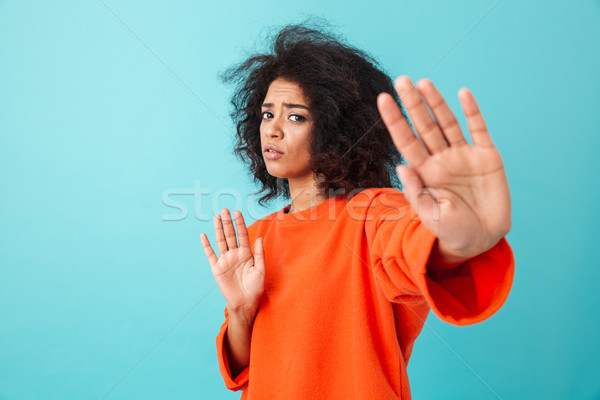 Colorful image closeup of determined woman expressing perplexity Stock photo © deandrobot