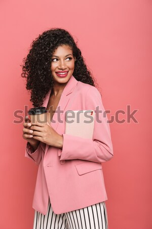Portrait of cheerful woman 20s holding cell phone and demonstrat Stock photo © deandrobot