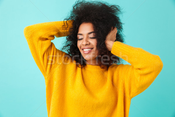 Colorful portrait of adorable woman in yellow shirt posing on ca Stock photo © deandrobot