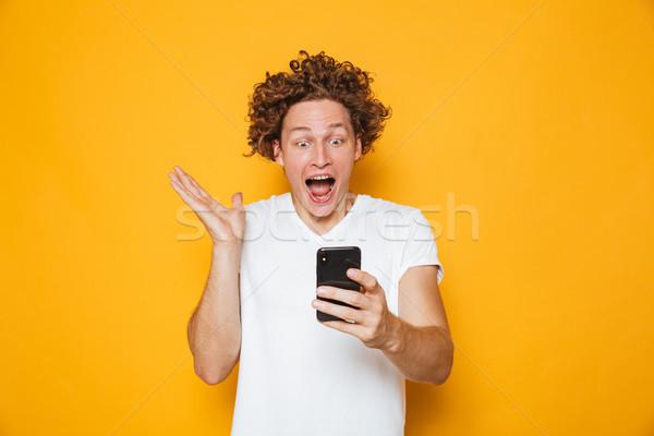 Excité européenne homme blanche tshirt Photo stock © deandrobot