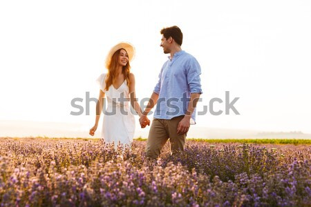 Lovely young couple holding hands Stock photo © deandrobot