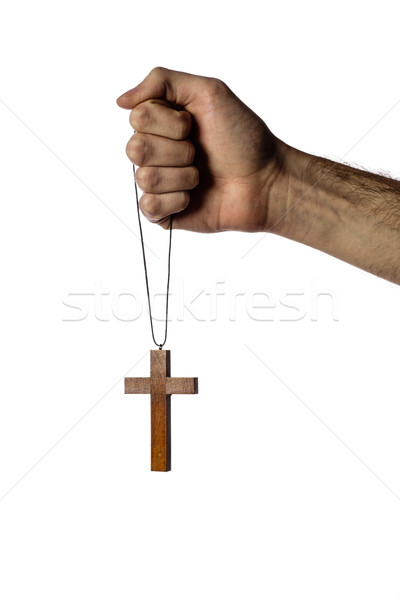 Male hand holding wooden cross on white background Stock photo © deandrobot