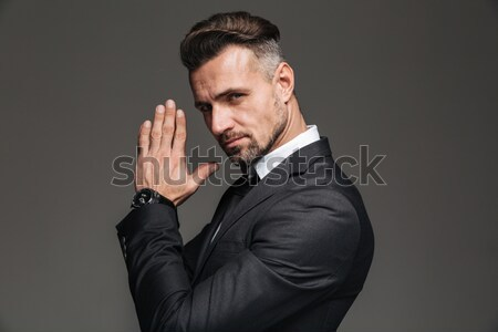 Businessman holding laptop and showing silence sign Stock photo © deandrobot