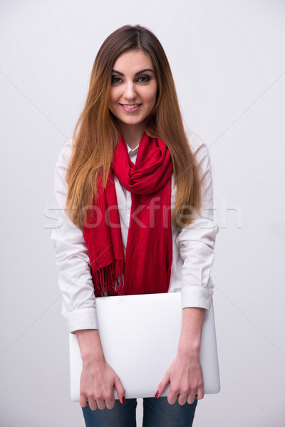 Portrait of a young smiling woman in red scarf with laptop Stock photo © deandrobot