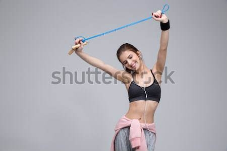 Happy sporty woman using smartwatch Stock photo © deandrobot