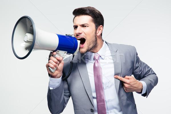 Imprenditore altoparlante grigio sfondo uomini Foto d'archivio © deandrobot