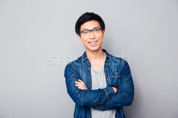 Retrato feliz Asia hombre armas doblado Foto stock © deandrobot