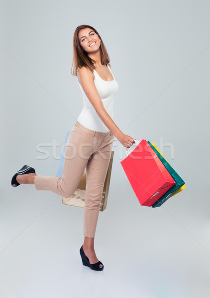 Happy woman holding shopping bags  Stock photo © deandrobot