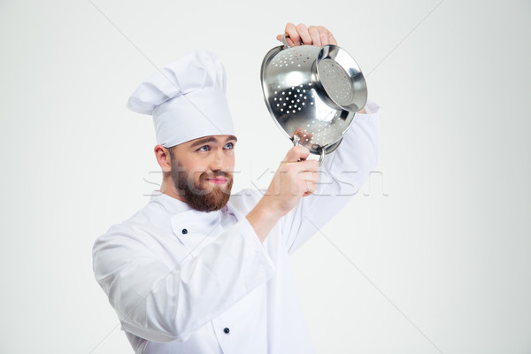 Male chef cook holding colander Stock photo © deandrobot