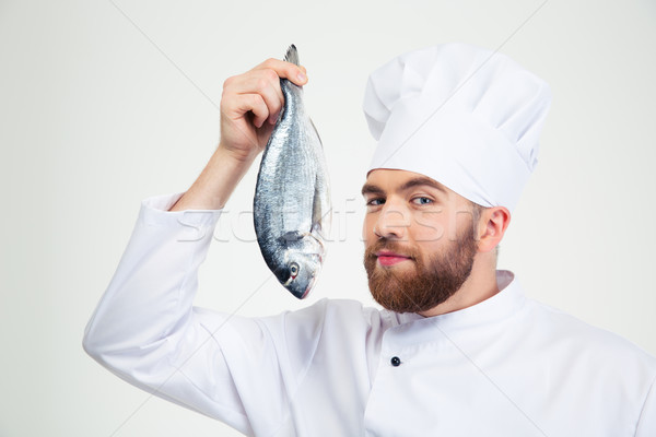 Handsome male chef cook holding fish Stock photo © deandrobot