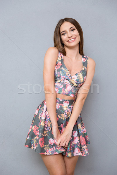 Portrait of young shy pretty girl in summer floral suit Stock photo © deandrobot