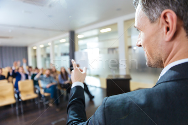 Speaker pointing to audience on business conference  Stock photo © deandrobot
