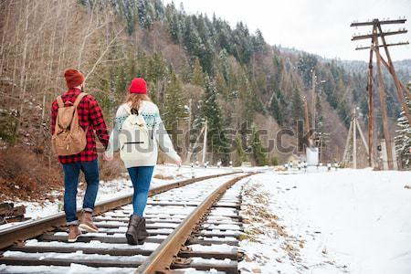 Hipster man walking on railway Stock photo © deandrobot