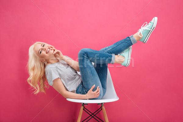 Feliz mujer silla rosa adolescente Foto stock © deandrobot